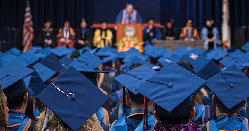 Graduate students receive degrees at graduation