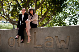 Pepperdine Law faculty posing and smiling on School of Law sign