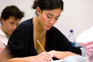 A student takes a test in class - Pepperdine University