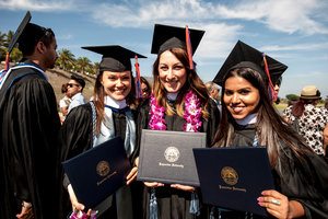 Students pose for pictures at graduation - Pepperdine University