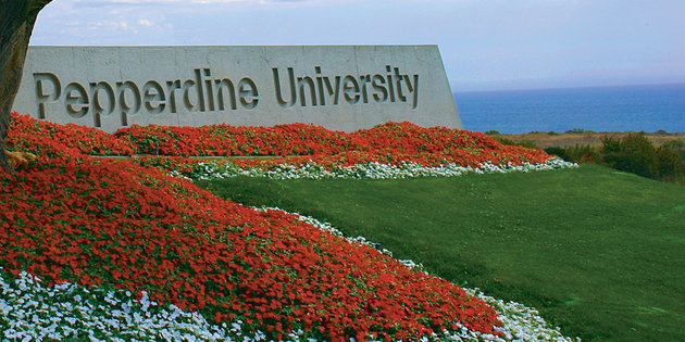 Pepperdine University Malibu campus entrance with red flowers - Pepperdine University