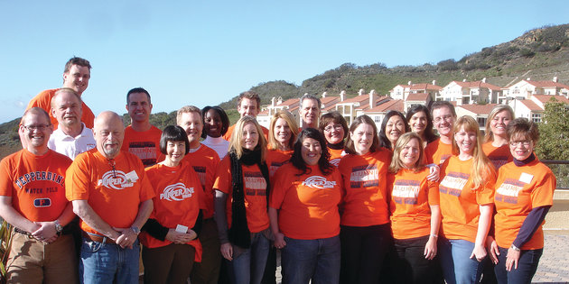 A group of alumni wearing orange shirts - Pepperdine University