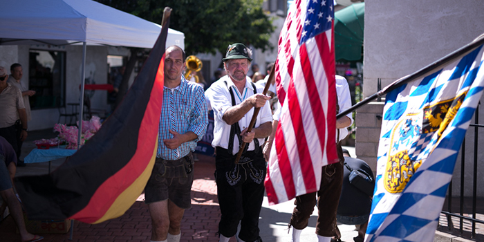 Two men holding German and American flags - Pepperdine University