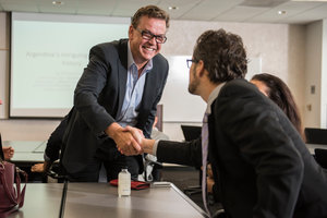 Two businessmen shake hands - Pepperdine University