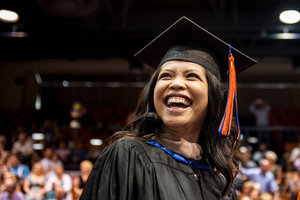 A student smiles during graduation - Pepperdine University