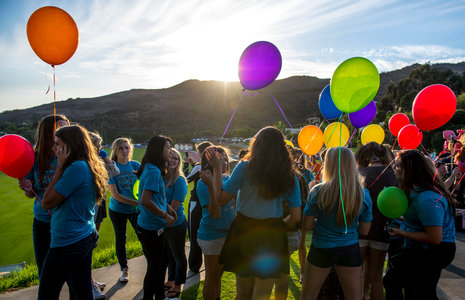 Students hold balloons - Pepperdine University