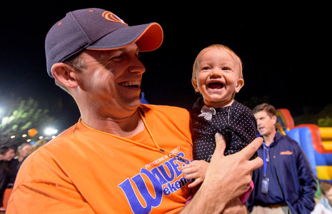 Alumnus holding his baby - Pepperdine University
