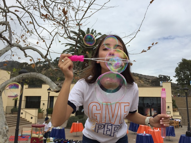 SPC president blowing bubbles at Give2Pepp