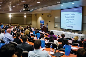 A GSBM lecture with a projection screen - Pepperdine University