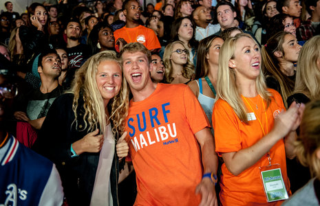 Seaver alumni in orange shirts attend a special event - Pepperdine University