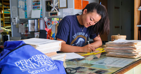 Student working at desk - Pepperdine University