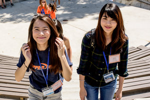 Two female Asian students walk on staircase - Pepperdine University