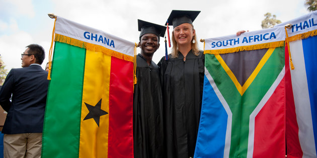 Students from Ghana and South Africa hold their national flags - Pepperdine University
