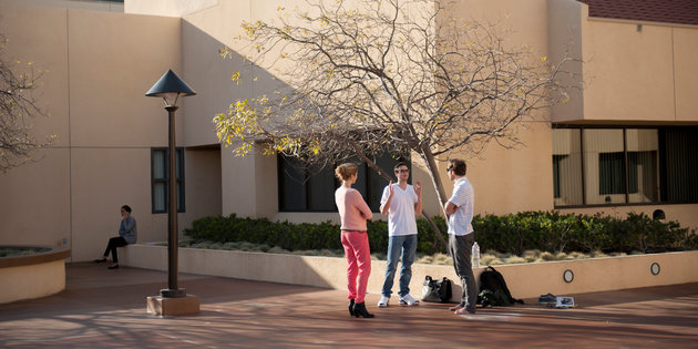 A group of international students speak on campus - Pepperdine University