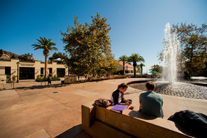 Two students study near a water fountain - Pepperdine University