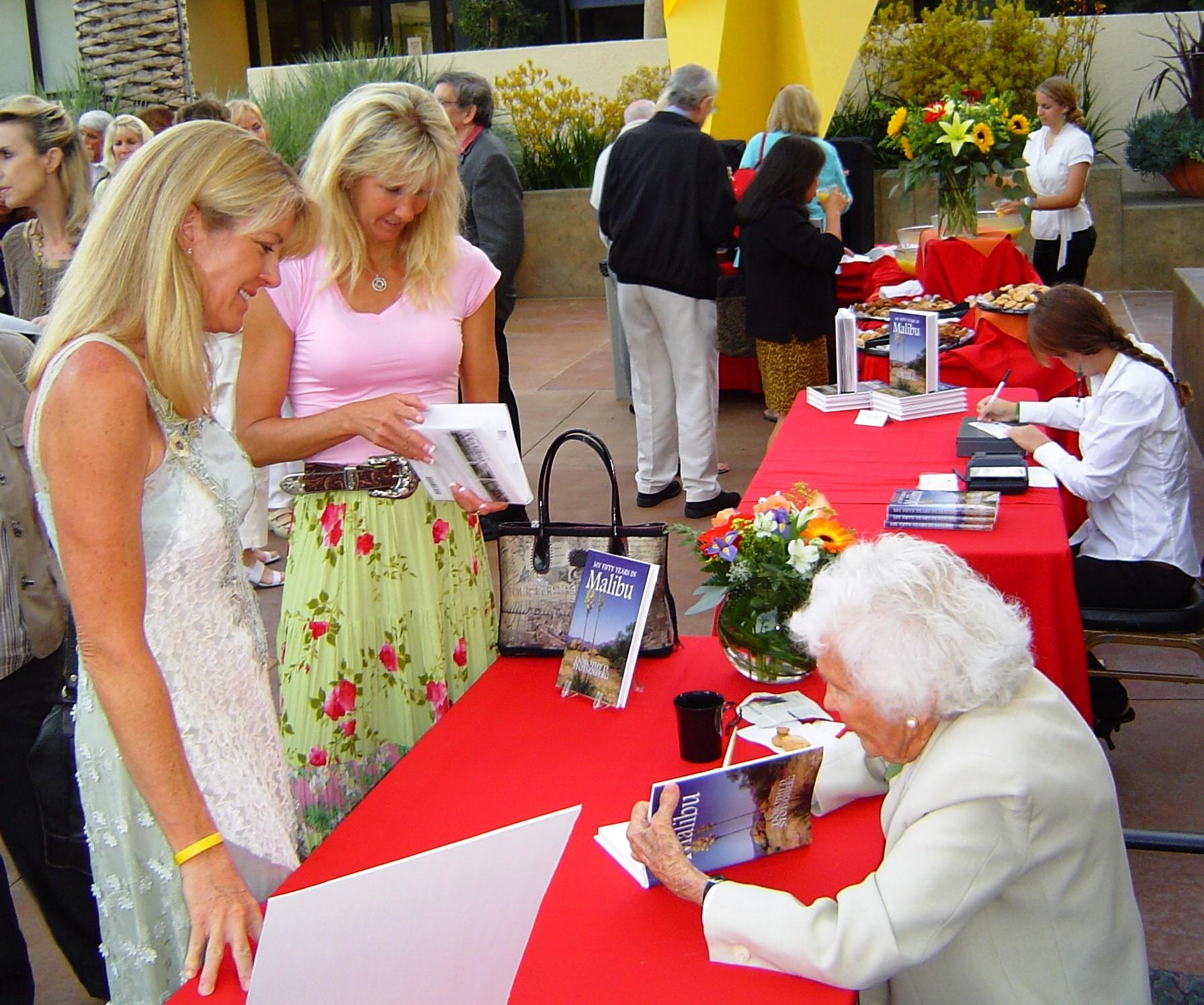 Crest Board member Dorothy Stotsenberg signs her book, 50 Years in Malibu