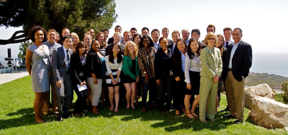 Pepperdine faculty and student pose together on the lawn