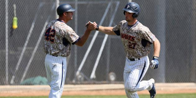 two baseball players wearing special veterans jerseys