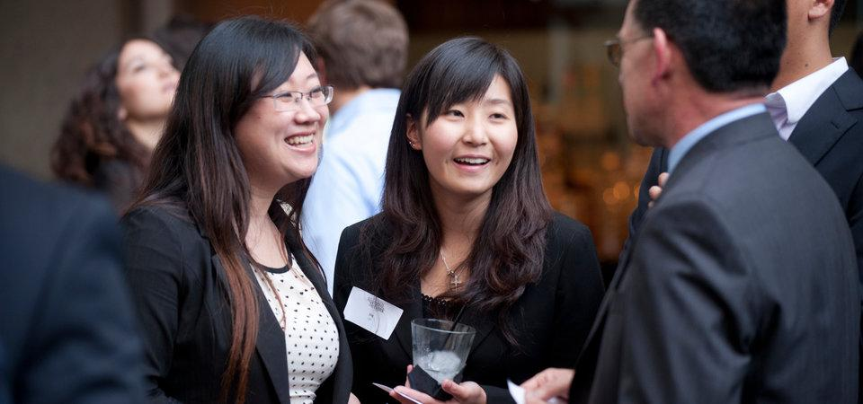 Business school students talking at an event
