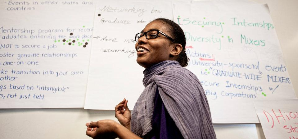 African American female student writing on the whiteboard