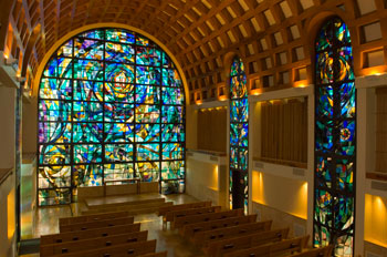 Inside of Stauffer Chapel with stained glass windows and pews - Pepperdine University