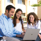 Students looking at laptop - Pepperdine University