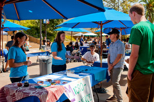 Students at a booth on campus - Pepperdine University