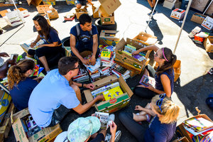 Waves of Service project with books - Pepperdine University