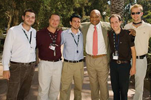 George Foreman poses for a picture with a group of students - Pepperdine University